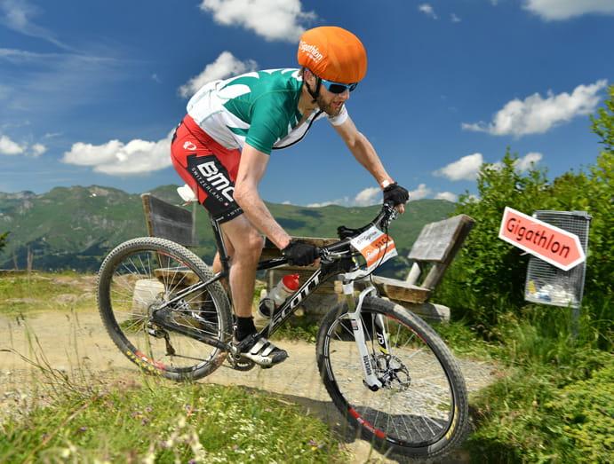 Ueli Niederhauser cycles along a trail during the Gigathlon.