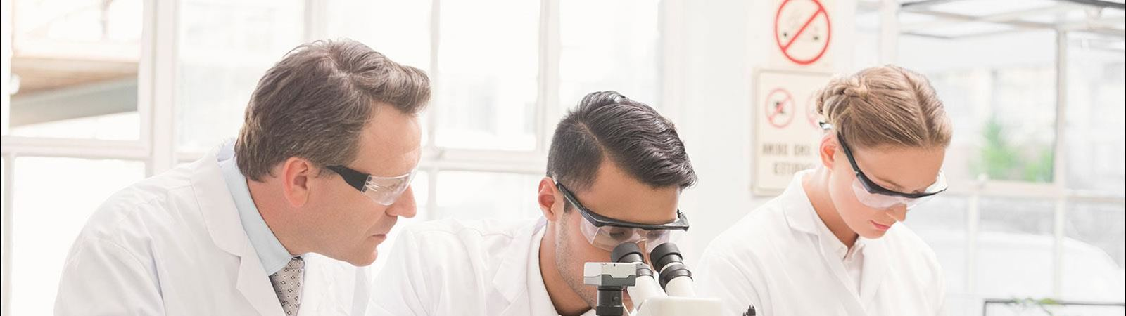 three researchers in a lab